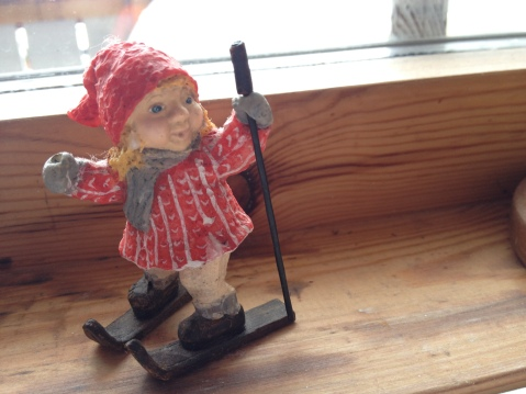 A lovely figure of a girl on skis (oops! she's lost one stick)